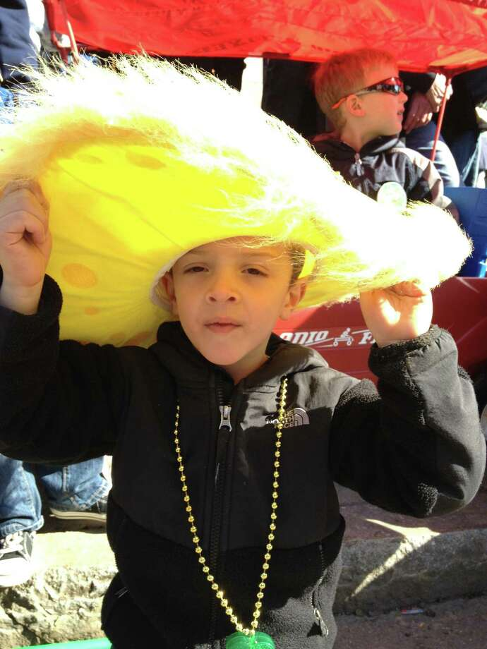 Jayden Soucy of Meriden shows his hat off at the parade Sunday. Phyllis Swebilus/Register