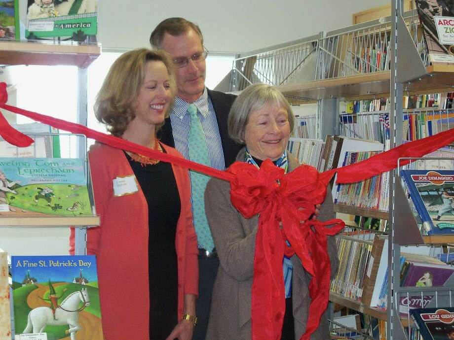 "Jonetta Badillo I Middletown Press Frances ""Franny"" English Reynolds, wife of the late John F. Reynolds, alongside her son, John English Reynolds, and daughter-in-law, Simone, cuts the ribbon as a symbol to the opening of a new library at Independent Day School. In addition to the celebration of the school's 50th anniversary, original members of the Board of Trustees, founding families and alumni gathered together to celebrate the milestone Friday."