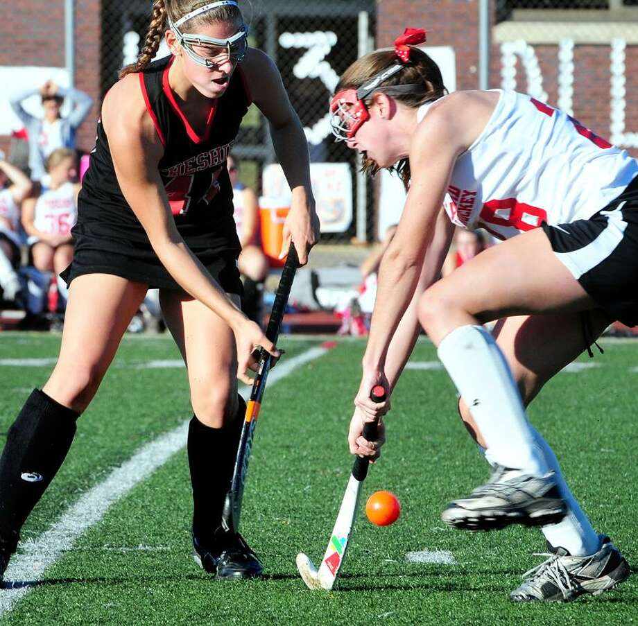 Cheshire's Michelle Federico, left, and Branford's Jenna Walsh fight for the ball during a regular-season matchup. Both teams will be looking to win state titles over the next two weeks. Photo by Arnold Gold/New Haven Register.