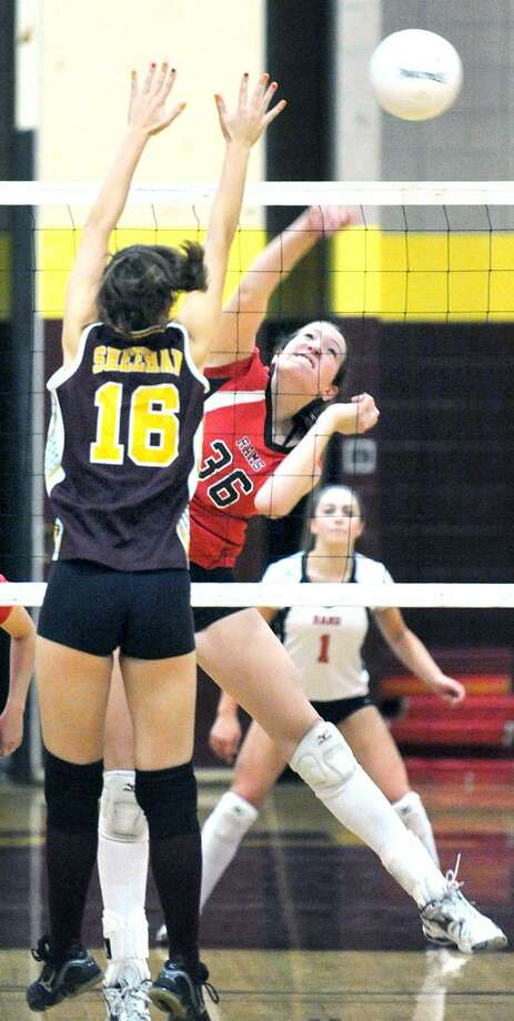 Sheehan's Makayla Ricci, left, tries to block a kill by Cheshire's Amanda Palladino during the regular season. Cheshire is the No. 2 seed in Class LL while Sheehan is No. 13 in Class M. Photo by Arnold Gold/New Haven Register