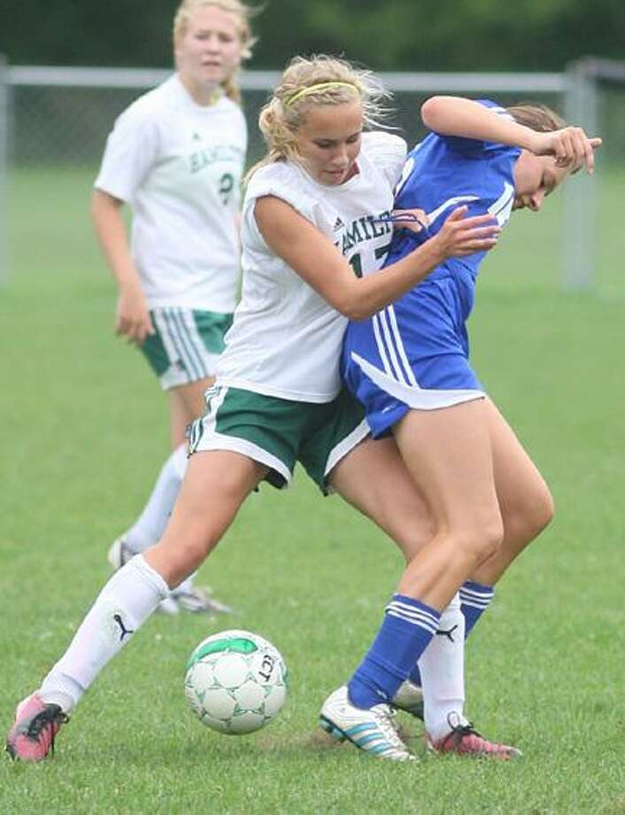 """Dispatch Staff Photo by JOHN HAEGER <a href=""""http://twitter.com/oneidaphoto"""">twitter.com/oneidaphoto</a>Hamilton's Clara Jones (17) fouls Poland's Tara Seigle (16) as they compete for the ball in the first half of their match in Hamilton on Saturday, Sept. 8, 2012. Poland won 6-0."""