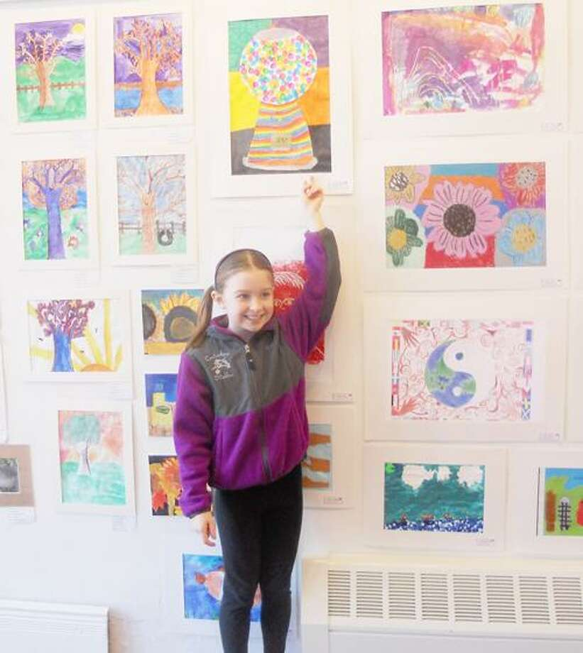 "Photo Courtesy EARLVILLE OPERA HOUSE Kamryn Roher, Grade 4 from Morrisville-Eaton Central School stands below her ""Gumball Machine."""