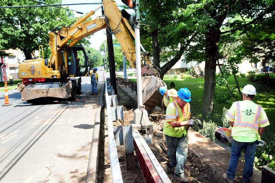 Work is under way on a sidewalk at the intersection of Fountain and Ramsdell streets in New Haven. Photo by Arnold Gold/New Haven Register