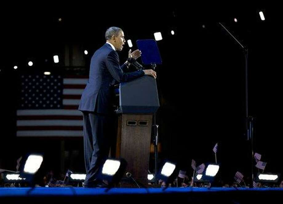 President Barack Obama speaks at the election night party Wednesday, Nov. 7, 2012, in Chicago. Obama defeated Republican challenger former Massachusetts Gov. Mitt Romney. (AP Photo/Carolyn Kaster) Photo: AP / AP