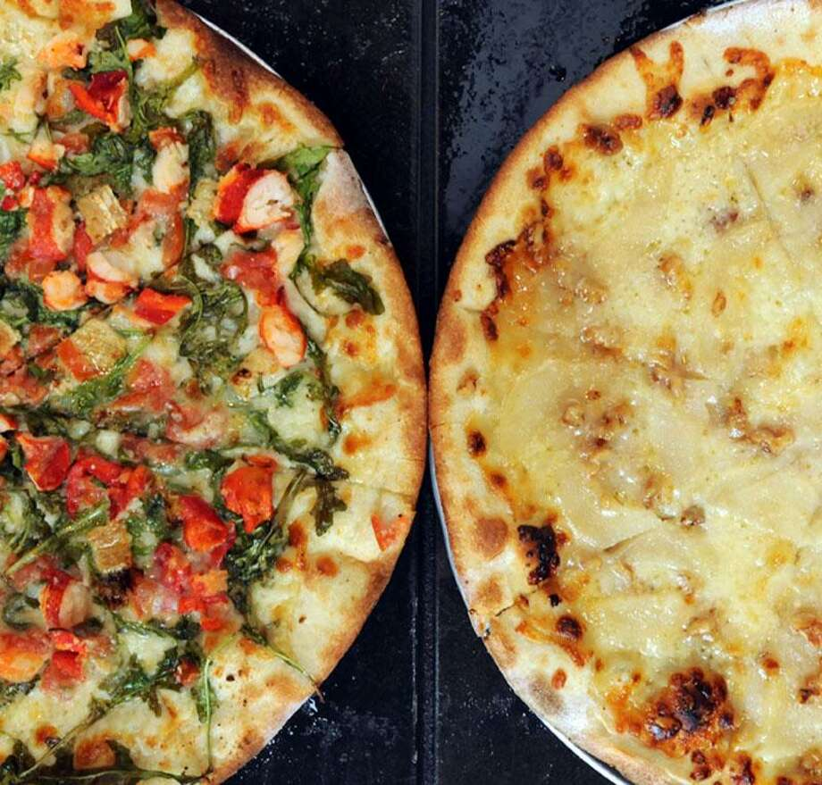 Lobster pizza, left, with picked lobster meat, fresh arugula, garlic confit diced plum tomatoes, mozzarella and brie cheese; and pear and gorgonzola pizza with Asian pears, gorgonzola and walnuts at Press Artisan Pizza, New Haven. Mara Lavitt/New Haven Register10/19/12