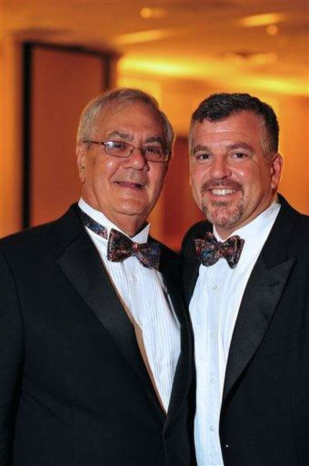 This image provided by Fotique shows U.S. Rep. Barney Frank, D-Mass., left, and Jim Ready posing at their wedding reception Saturday. Frank married his longtime partner in a ceremony officiated by Massachusetts Gov. Deval Patrick in Newton, Mass. Associated Press Photo: ASSOCIATED PRESS / AP2012