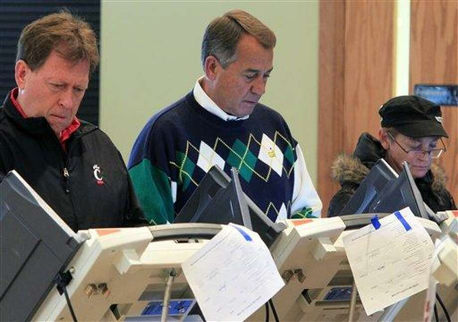 Speaker John Boehner, R-Ohio, center, votes at Ronald Reagan Lodge on Tuesday in West Chester, Ohio. (AP Photo) Photo: AP / AP