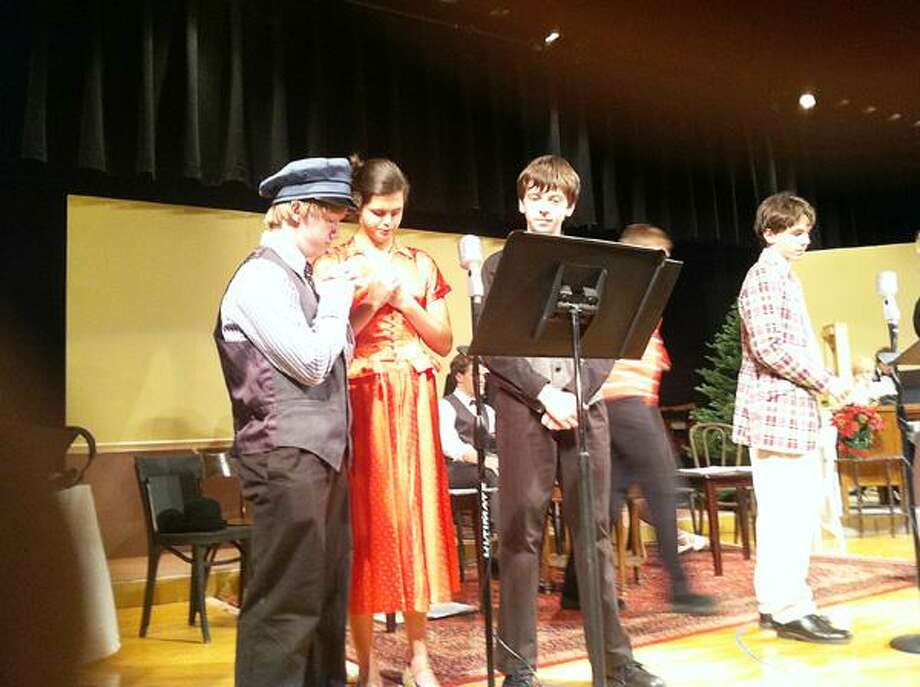 """Dispatch Staff Photo by NICK WILL Members of Hamilton's drama club rehearse a scene from """"It's a Wonderful Life"""" on Monday. The play runs Friday and Saturday, Nov. 9-10 at 7 p.m."""