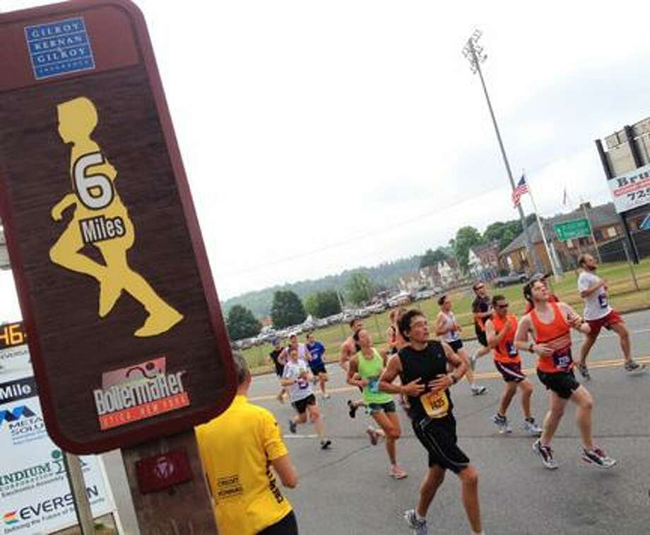 Dispatch Staff Photo by JOHN HAEGER (Twitter.com/OneidaPhoto)Runners pass the six-mile marker during the 35th annual 15k Boilermaker road race on Sunday, July 8, 2012 in Utica.