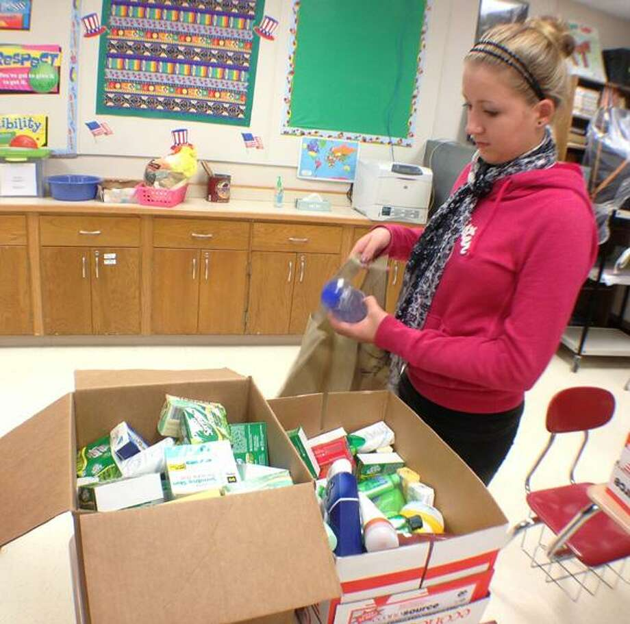 "Dispatch Staff Photo by JOHN HAEGER <a href=""http://twitter.com/oneidaphoto"">twitter.com/oneidaphoto</a> Leos Club member Alicia LaFever packs a family hygiene  kit on Wednesday, Nov. 7, 2012 at Morrisville Eaton Central School. Students collected move than 1000 items which were then made into more the 50 kits to be give to the local food pantry."