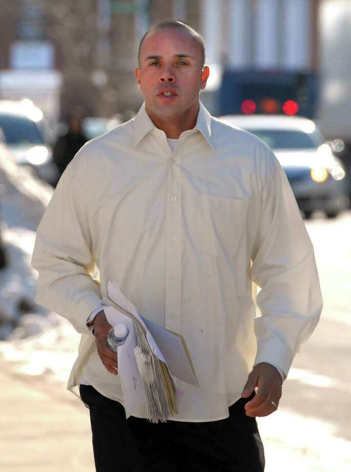 Angelo Reyes of New Haven runs to a hearing at Federal Court in Hartford. Photo by Mara Lavitt/New Haven Register1/31/11