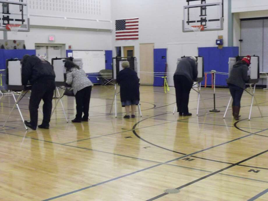 Nikki Treleaven/Register Citizen Voters cast their ballots at Torringford School, Torrington, on Tuesday morning.