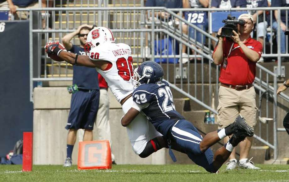 Sep 8, 2012; East Hartford, CT, USA; North Carolina State Wolfpack wide receiver Bryan Underwood (80) make s adiving touchdown against Connecticut Huskies cornerback Taylor Mack (29) during the second half at Rentschler Field. North Carolina State defeated the Huskies 10-7. Mandatory Credit: David Butler II-US PRESSWIRE Photo: US PRESSWIRE / David Butler II