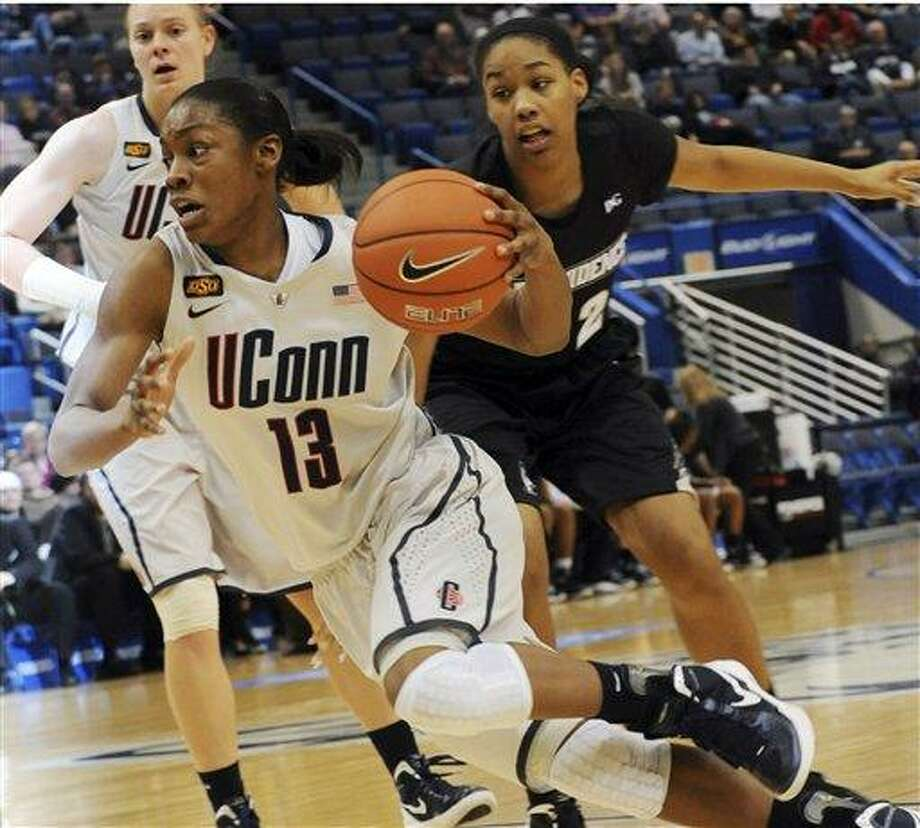 Connecticut's Brianna Banks brings the ball down the floor against Providence during the second half of an NCAA college basketball game in Hartford, Conn., Tuesday, Jan. 10, 2012. UConn won 96-35.  (AP Photo/Bob Child) Photo: AP / FR170410 AP