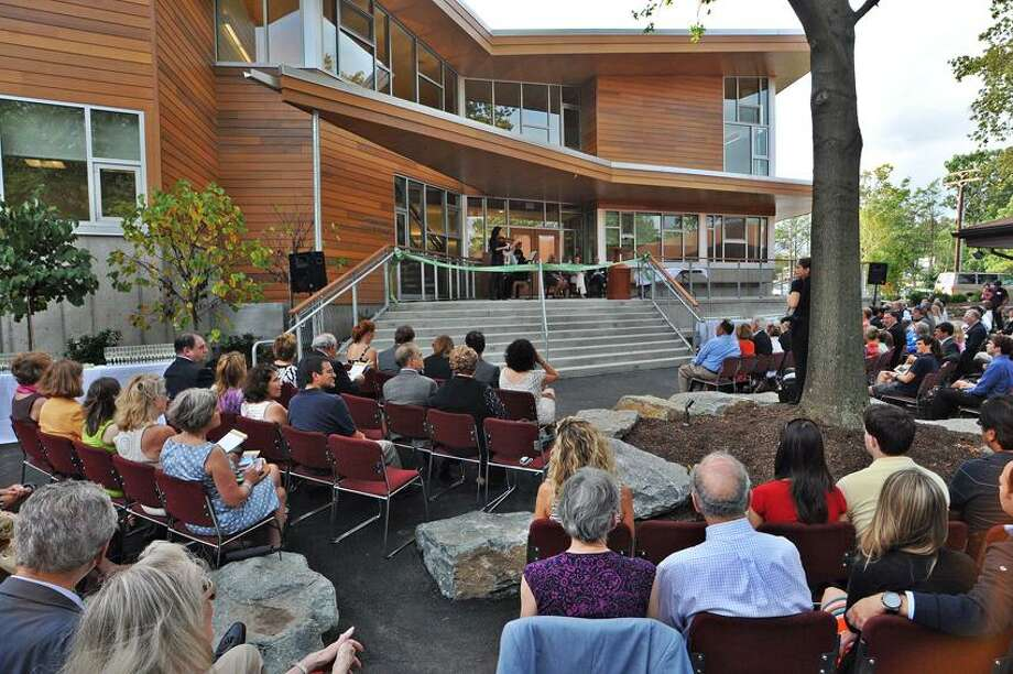 New Haven-- Violinist Yaira Matyakubova and pianist Andrius Zlabys, parent's of a Foote School 2nd grader, plays for the crowd during the dedication of the new Jonathan Milikowsky Science and Technology Building on the Foote School Campus. Photo Peter Casolino/New Haven Register 09/08/2012