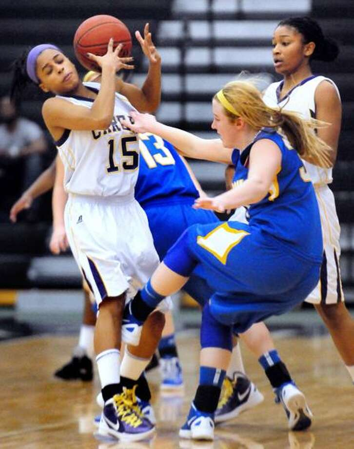 Kelsey Gibbons, left, of Career comes up with a turnover as Cassie Santoro, right, of Mercy tries to regain her balance in the second half at the Floyd Little Athletic Center in New Haven. Photo by Arnold Gold/New Haven Register