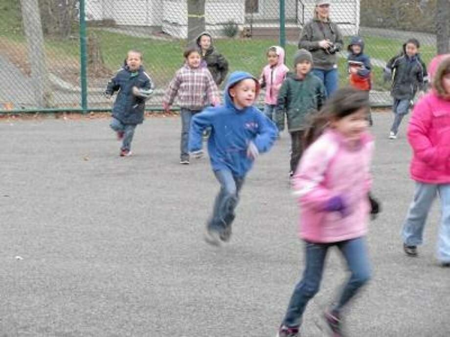 Photo by Nikki Treleaven/Register Citizen First-grade students at Southwest Elementary School in Torrington take part in the second annual Fall Fun Run on Wednesday to help raise money for a new playground at their school.