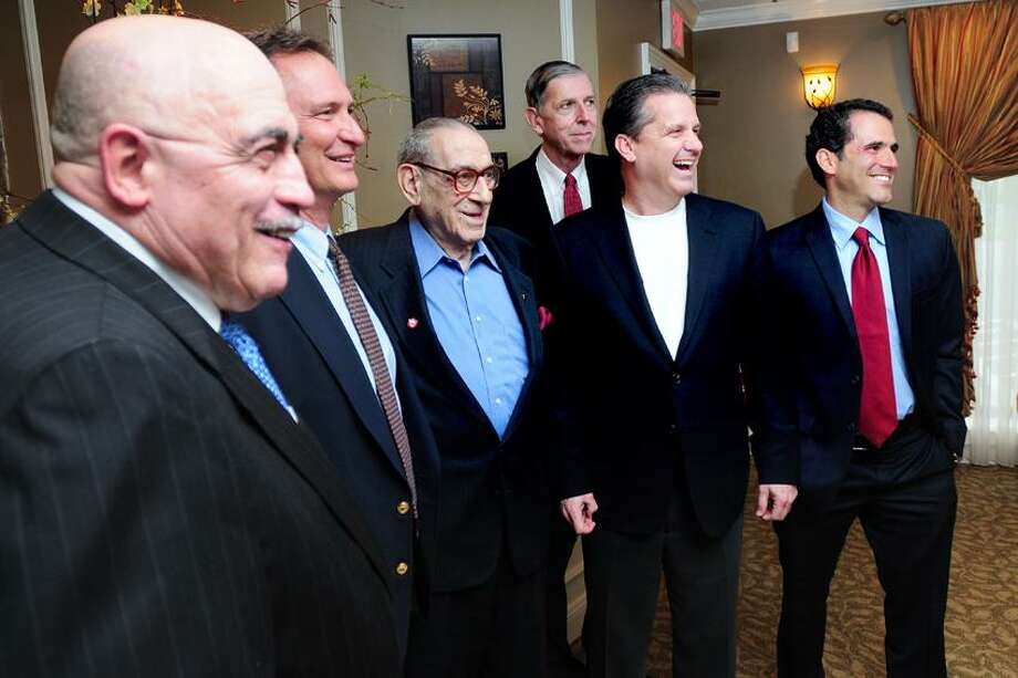 Left to right, St. Joseph High School boys basketball coach Vito Montelli, St. Joseph athletic director Jim Olayos, Howard Garfinkel, Tom Konchalski, University of Kentucky men's basketball coach John Calipari and Sports Illustrated reporter Seth Davis are photographed at a banquet at Vazzano's Four Seasons in Stratford on 5/9/2012. Photo by Arnold Gold/New Haven Register   AG0448C