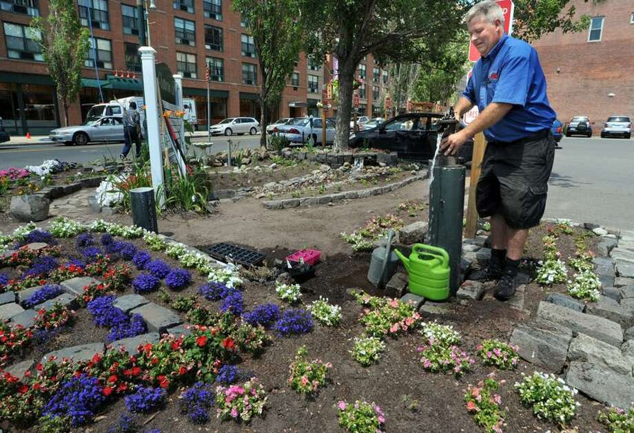 LAZ Parking lot attendant Donald Flumerfelt of New Haven has created a garden oasis at the Chatterton Lot, a parking lot in New Haven at the corner of George and Orange Sts.  Mara Lavitt/New Haven Register7/3/12