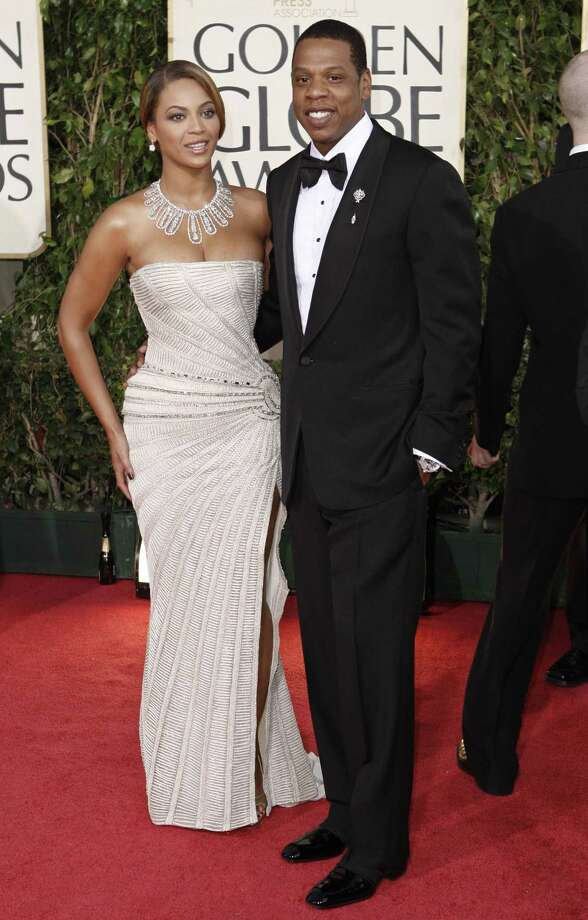 "FILE - In this Jan. 11, 2009 file photo, Beyonce, left, is joined by husband Jay-Z, as she arrives at the 66th Annual Golden Globe Awards in Beverly Hills, Calif. Through a rap verse, Jay-Z has confirmed the birth of ""the most beautiful girl in the world"" _ his newborn daughter.  The song ""Glory"" made its debut on his social website Monday, Jan. 9, 2012, two days after he and Beyonce reportedly gave birth to a daughter, Blue Ivy. Photo: ASSOCIATED PRESS / AP2009"