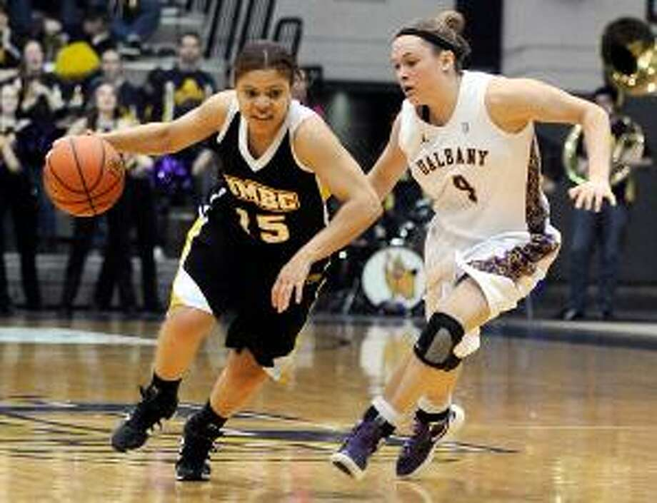 ASSOCIATED PRESS Albany's Sarah Royals (4) pressures UMBC's Raven Harris (15) during the America East Conference championship game in Albany, N.Y. The Lady Danes won 69-61 to claim their first America East title and NCAA tournament bid.