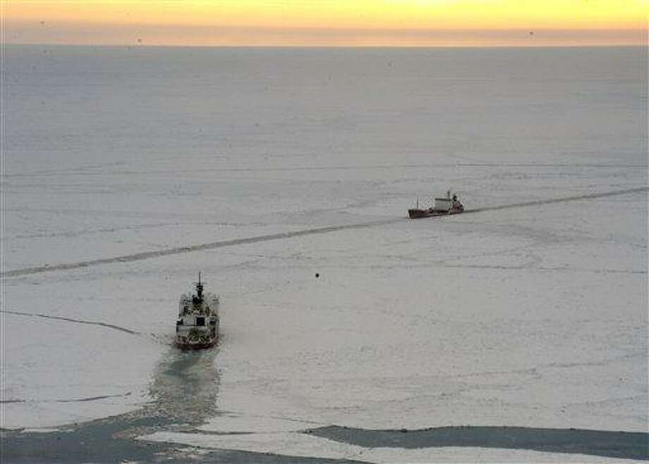 In this Jan. 7 photo provided by the U.S. Coast Guard, the Coast Guard Cutter Healy crew steers their ship along side the tanker Renda as they conduct a return cut through the ice in the bearing Sea near Nome, Alaska. Shifting ice in the Bering Sea that at times is pinching the sides of the Russian tanker is raising the specter that a mission to deliver fuel to an iced-in Alaska community might not be possible. Associated Press Photo: AP / U.S. Coast Guard