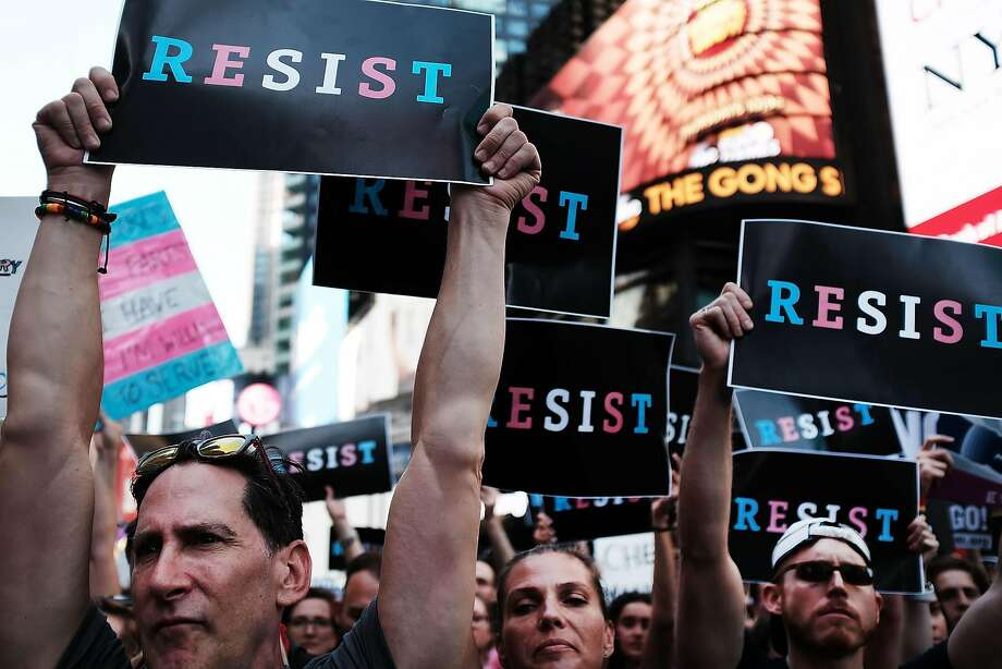 Protesters in Times Square in New York show their anger Wednesday at President Trump's tweet promising to reinstate a ban on transgender people from serving in the military. Photo: Spencer Platt, Getty Images