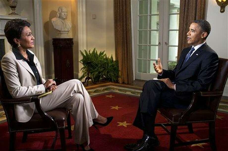 In this photo released by The White House, President Barack Obama participates in an interview with Robin Roberts of ABC's Good Morning America, in the Cabinet Room of the White House, Wednesday, in Washington. Obama declared his unequivocal support for gay marriage on Wednesday, a historic announcement that gave the polarizing social issue a more prominent role in the 2012 race for the White House. Photo: AP / The White House