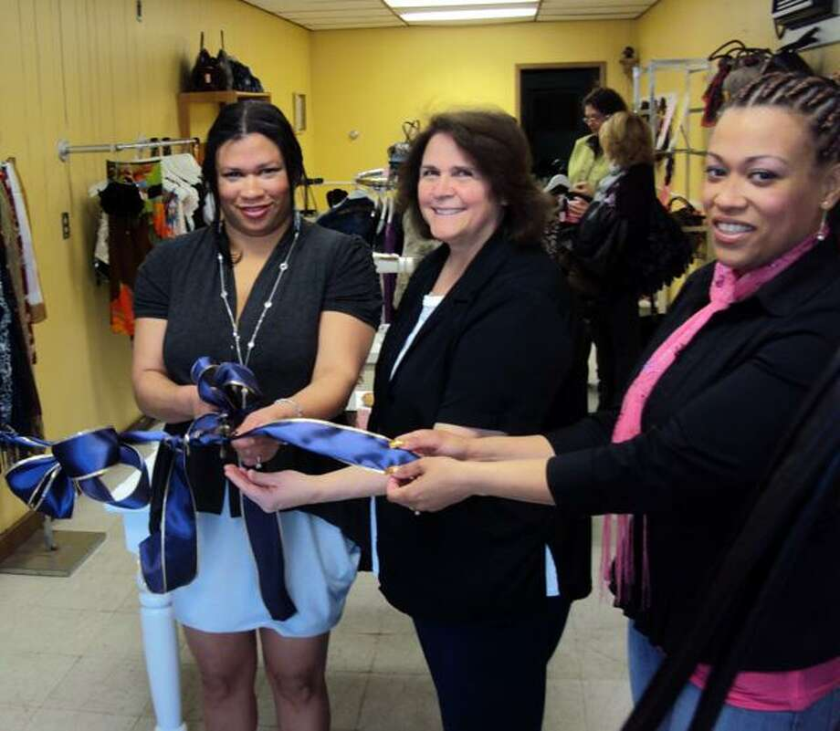 RICKY CAMPBELL/ Register Citizen New store owner Yajaira Duran, Winsted Mayor MaryAnn Welcome and Maribel Baez prepare a ribbon-cutting Saturday at Yajaira's, 452 Main St., in Winsted. The new retail boutique store held its grand opening with members from town hall, Friends of Main Street and the community on hand.