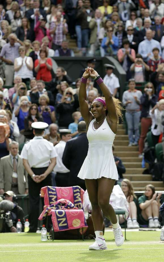 ASSOCIATED PRESS Serena Williams of the United States reacts after defeating Agnieszka Radwanska of Poland to win the women's final match at the All England Lawn Tennis Championships at Wimbledon, England, Saturday.