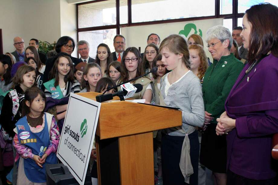 Submitted photo Girl Scout Corrine Winklow speaks to those in attendance. Lieutenant Governor Nancy Wyman and Secretary of the State Denise Merrill are on her right.