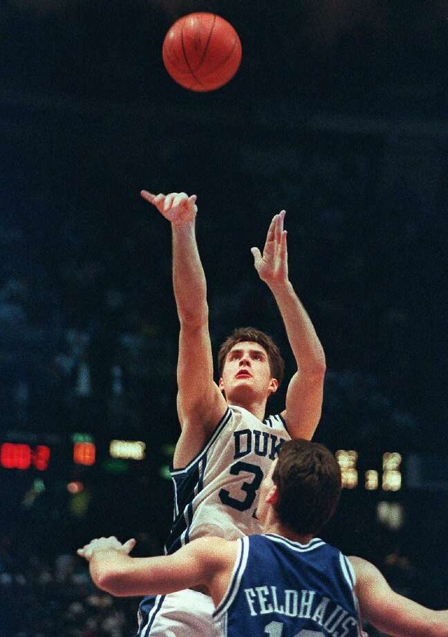 ASSOCIATED PRESS In this March 28, 1992 file photo, Duke's Christian Laettner shoots the game-winning basket in overtime over Kentucky's Deron Feldhaus to win the East Regional final in Philadelphia. Duke beat Kentucky 104-103. Laettner says it doesn't feel like it has been 20 years since his famous shot lifted Duke to victory, in part because the much-celebrated play still is replayed so often on TV. As Duke is back for another postseason run, Laettner now is far removed from that national spotlight as a new assistant coach for the NBA D-League Fort Wayne Mad Ants.