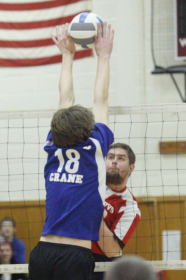 """Dispatch Staff Photo by JOHN HAEGER <a href=""""http://twitter.com/oneidaphoto"""">twitter.com/oneidaphoto</a> VVS Noah Treadway (30) has his shot blocked by Ichabod Crane Alex Potts (18) defends in the New York State Class B Regional final in Canastota on Saturday, March 10, 2012. Ichabod Crane  won the title in three games."""