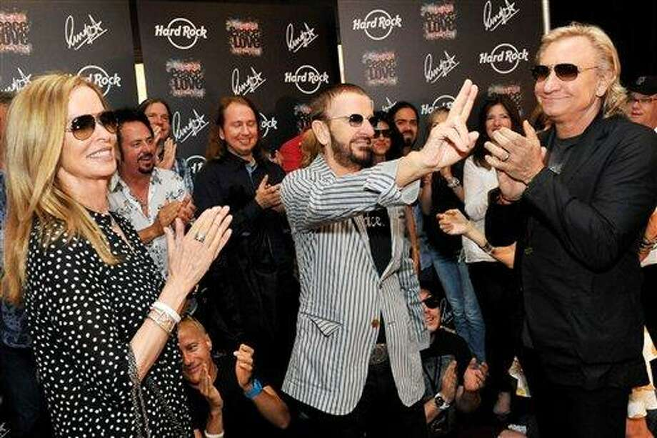 In this photo provided by Rob Shanahan, musician Ringo Starr, center, celebrates his 72nd birthday with his wife Barbara Bach, left, and musician Joe Walsh, right, at The Hard Rock Cafe, Saturday, July 7, 2012, in Nashville, Tenn. (AP Photo/Rob Shanahan) Photo: AP / © Rob Shanahan 2012