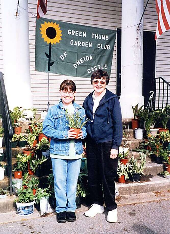 Photo Courtesy GREEN THUMB GARDEN CLUB From left, Courtney Croasdaile and her grandmother, Janice Freer, prepare for the sale.