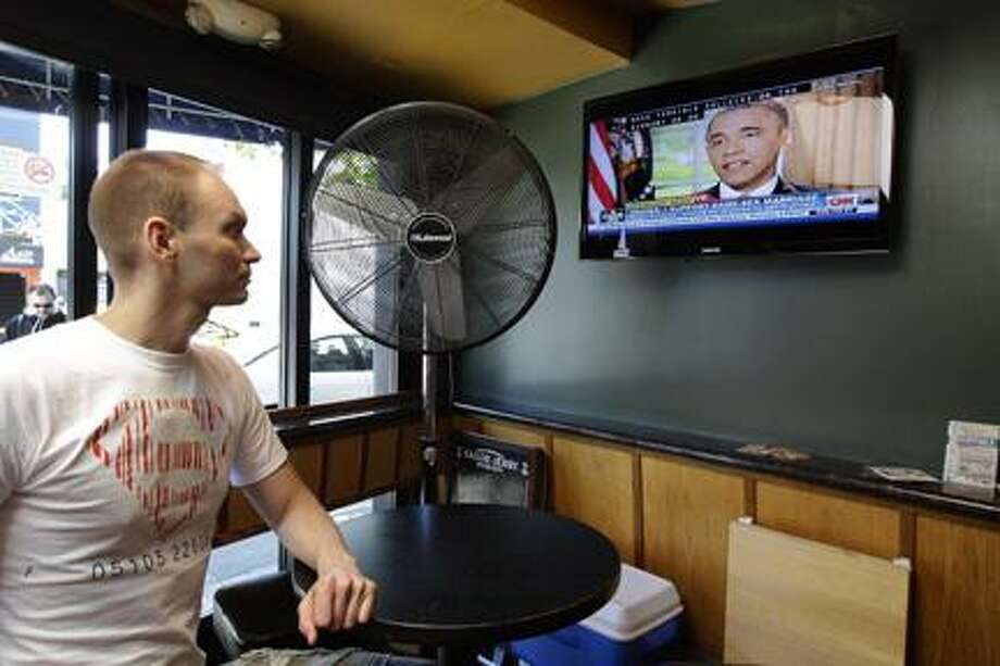 AP Photo/Ben MargotJase Peeples watches a television broadcast of President Obama declaring his support of same-sex marriage Wednesday, May 9, 2012, at The Mix bar in San Francisco. President Obama announced that he now supports same-sex marriage, reversing his longstanding opposition amid growing pressure from the Democratic base and even his own vice president. Peeples, who has lived with his partner for nine years, welcomed the news. Photo: ASSOCIATED PRESS / AP2012