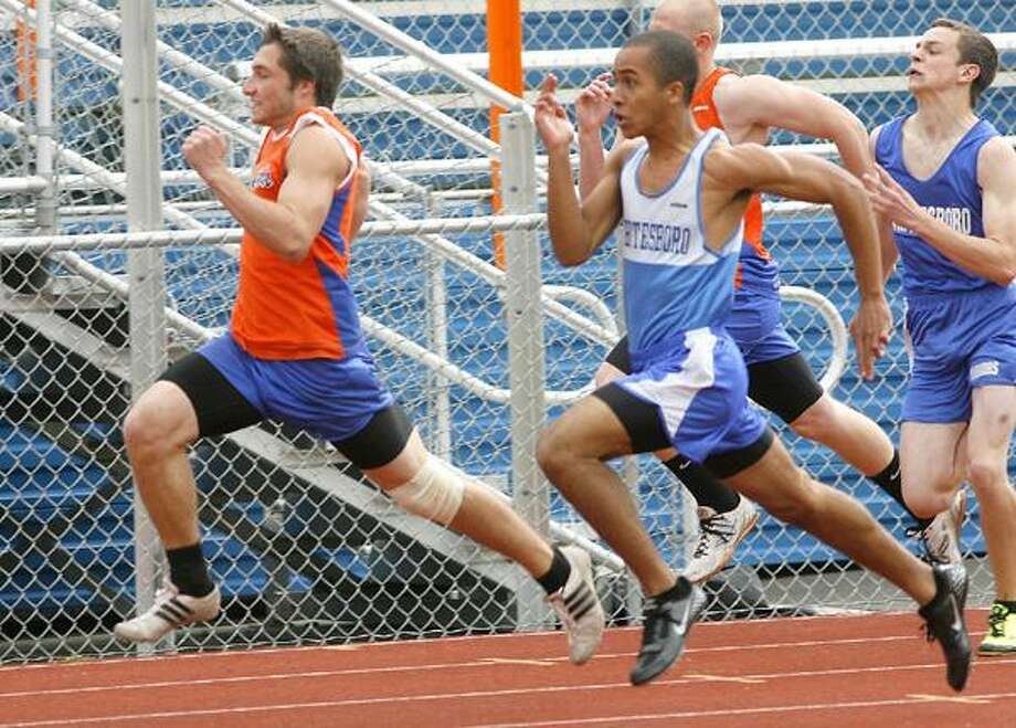 """Dispatch Staff Photo by JOHN HAEGER <a href=""""http://twitter.com/oneidaphoto"""">twitter.com/oneidaphoto</a>Oneida's Jimmy Moyer takes the early lead against Whitesboro's Chris Hunter in the 100 meter dash on Wednesday, May 9, 2012 in Oneida. Hunter edged out Moyer at the line for the win."""