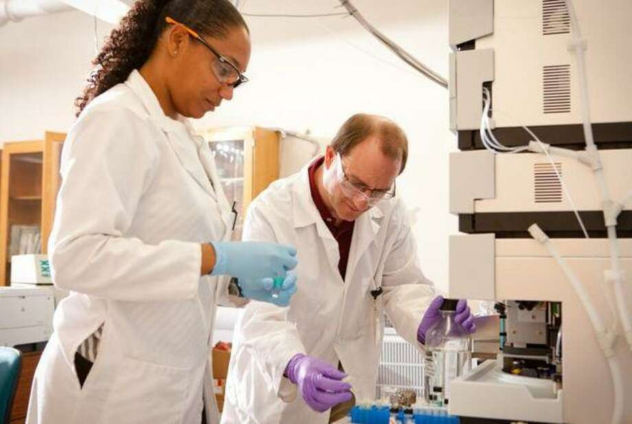 SUNY BUFFALO RESEARCH: Charmion Cruickshank and Troy Wood. Wood, an associate professor of chemistry, heads a study that could one day contribute to the development of a biological test for autism -- SUNY photo.