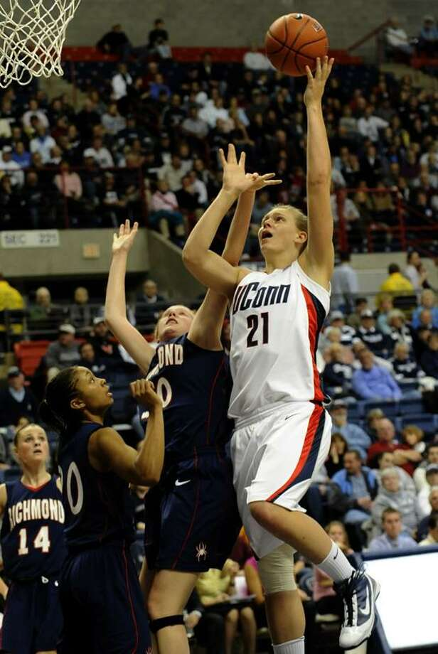 Stonington's Heather Buck (21) has not seen an abundance of playing time in her career at UConn, but she has no regrets about sticking with the Huskies. (AP file photo) Photo: AP / AP2009