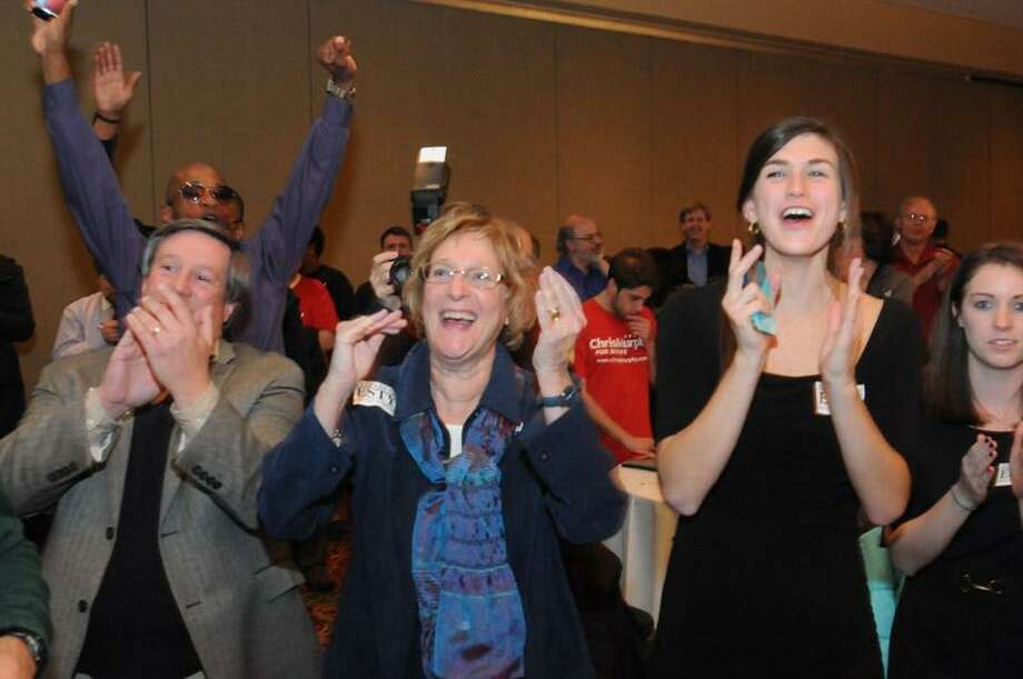Crowd reacts to Wyman speech at Esty headquarters Tuesday night. Mara Lavitt/New Haven Register