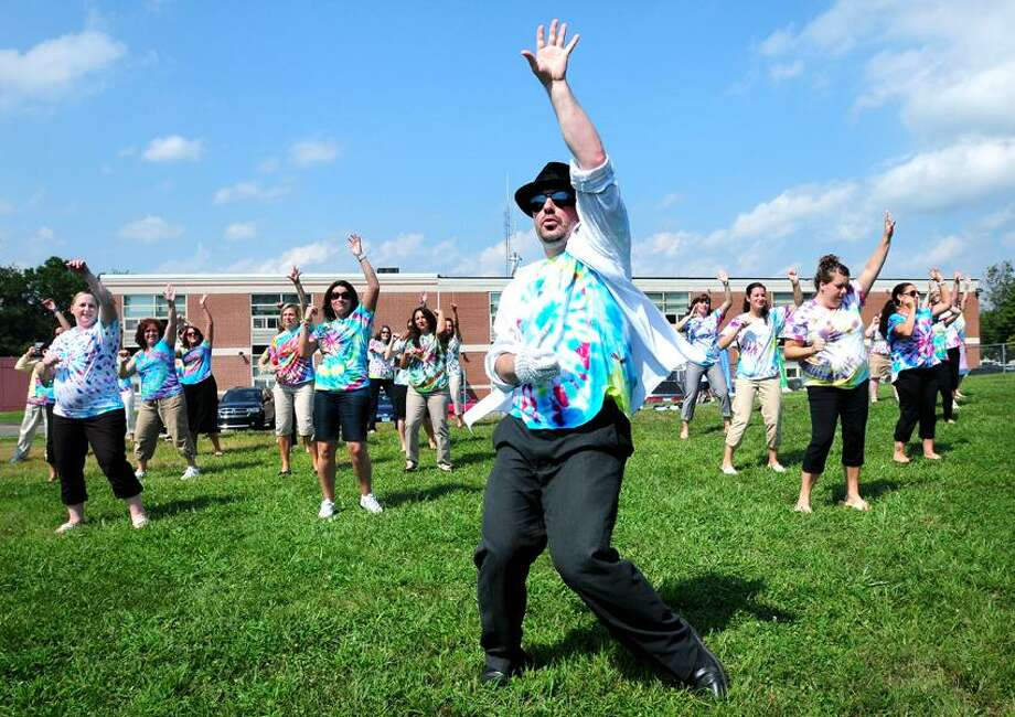Fifth grade teacher Chris Pytlak (center) as Michael Jackson leads the staff of Prendergast Elementary School in a rendition of Beat It during an assembly outside of the school in Ansonia on 9/7/2012.Photo by Arnold Gold/New Haven Register    AG0461E