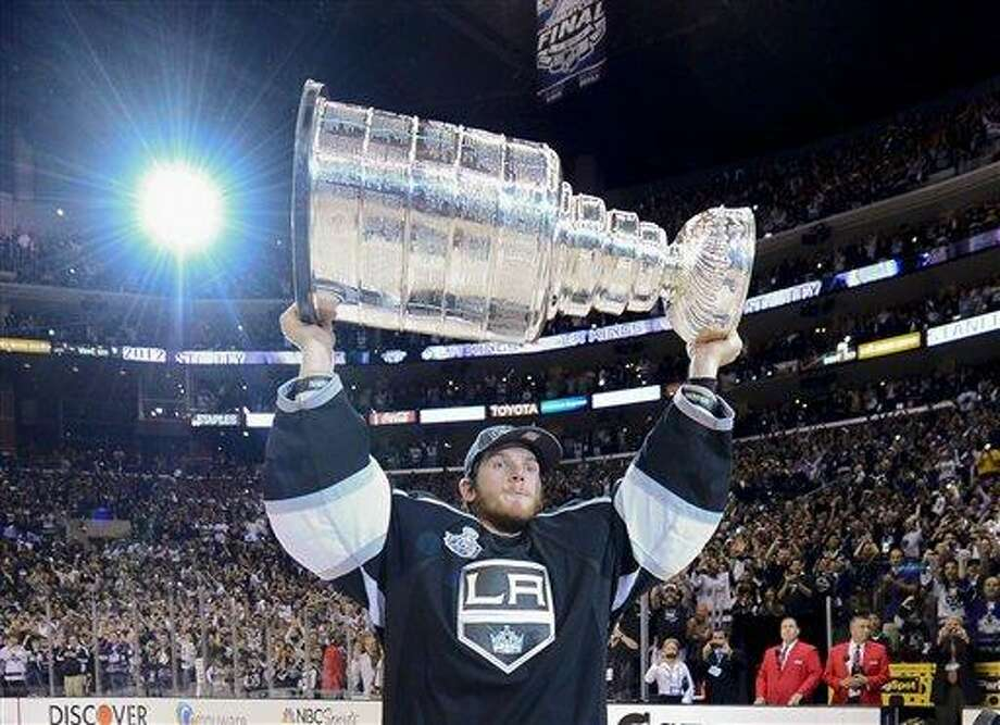Los Angeles Kings goalie Jonathan Quick (32) holds up the Stanley Cup after the Kings beat the New Jersey Devils 6-1during Game 6 of the NHL hockey Stanley Cup finals, Monday, June 11, 2012, in Los Angeles. (AP Photo/Mark J. Terrill) Photo: ASSOCIATED PRESS / AP2012