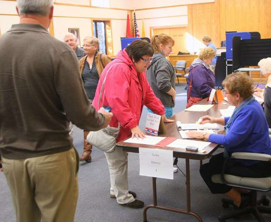 """Dispatch Staff Photo by JOHN HAEGER <a href=""""http://twitter.com/oneidaphoto"""">twitter.com/oneidaphoto</a> People sign in to cast their ballot in the Town District 4 elections on Tuesday  , Nov. 6, 2012 in Sherrill. As of noon some 400 resident has cast their vote."""