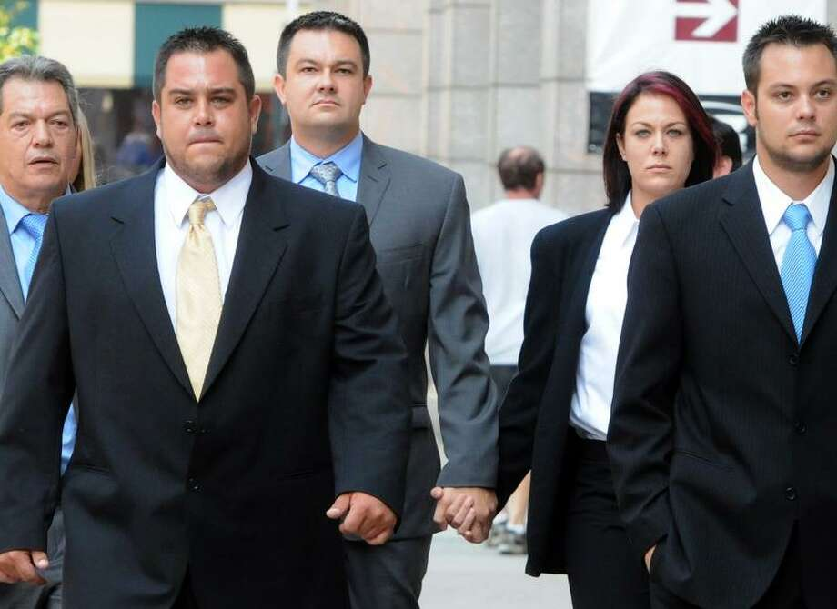 David Canizares, third from left, walks to New Haven Superior Court Friday, September 7, 2012 , where he was sentenced to 9-years in prison for manslaughter in the 2009 death of his infant niece Makayla Lynn Aseltine. Photo by Peter Hvizdak / New Haven Register Photo: New Haven Register / ©Peter Hvizdak /  New Haven Register