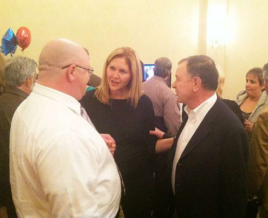 Dispatch Staff Photo by NICK WILL Republican Richard Hanna stands with his wife Kim and supporter Chris Salow at the Hotel Utica on Tuesday.