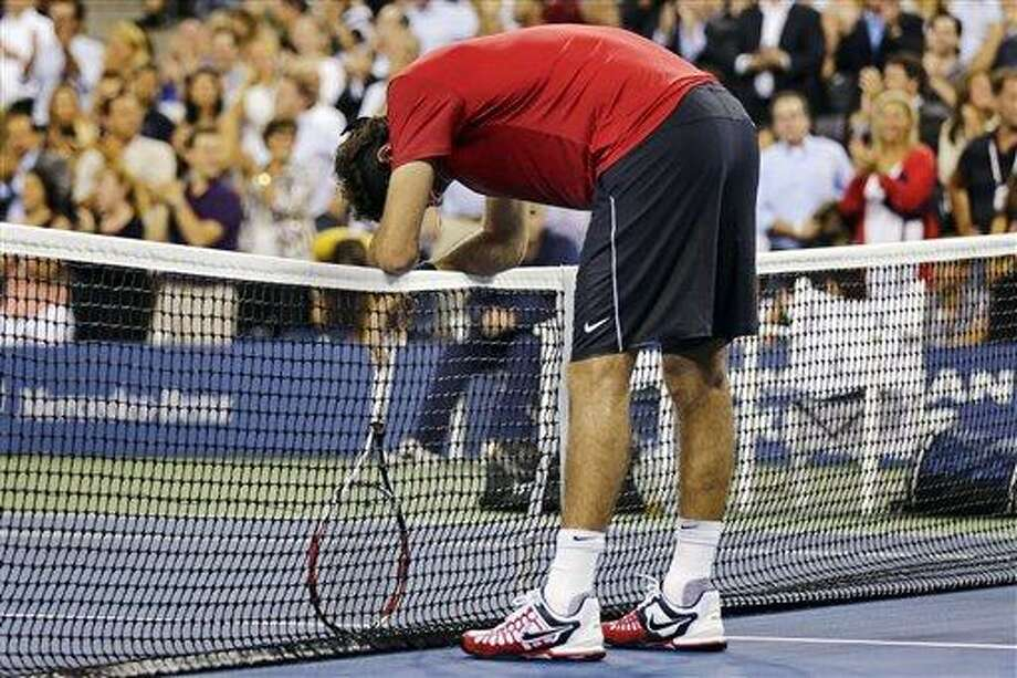 Juan Martin del Potro, of Argentina, rests on the net after losing a point during the second set against Novak Djokovic, of Serbia, in the quarterfinal round of play at the U.S. Open tennis tournament, Thursday, Sept. 6, 2012, in New York. (AP Photo/Charles Krupa) Photo: AP / AP
