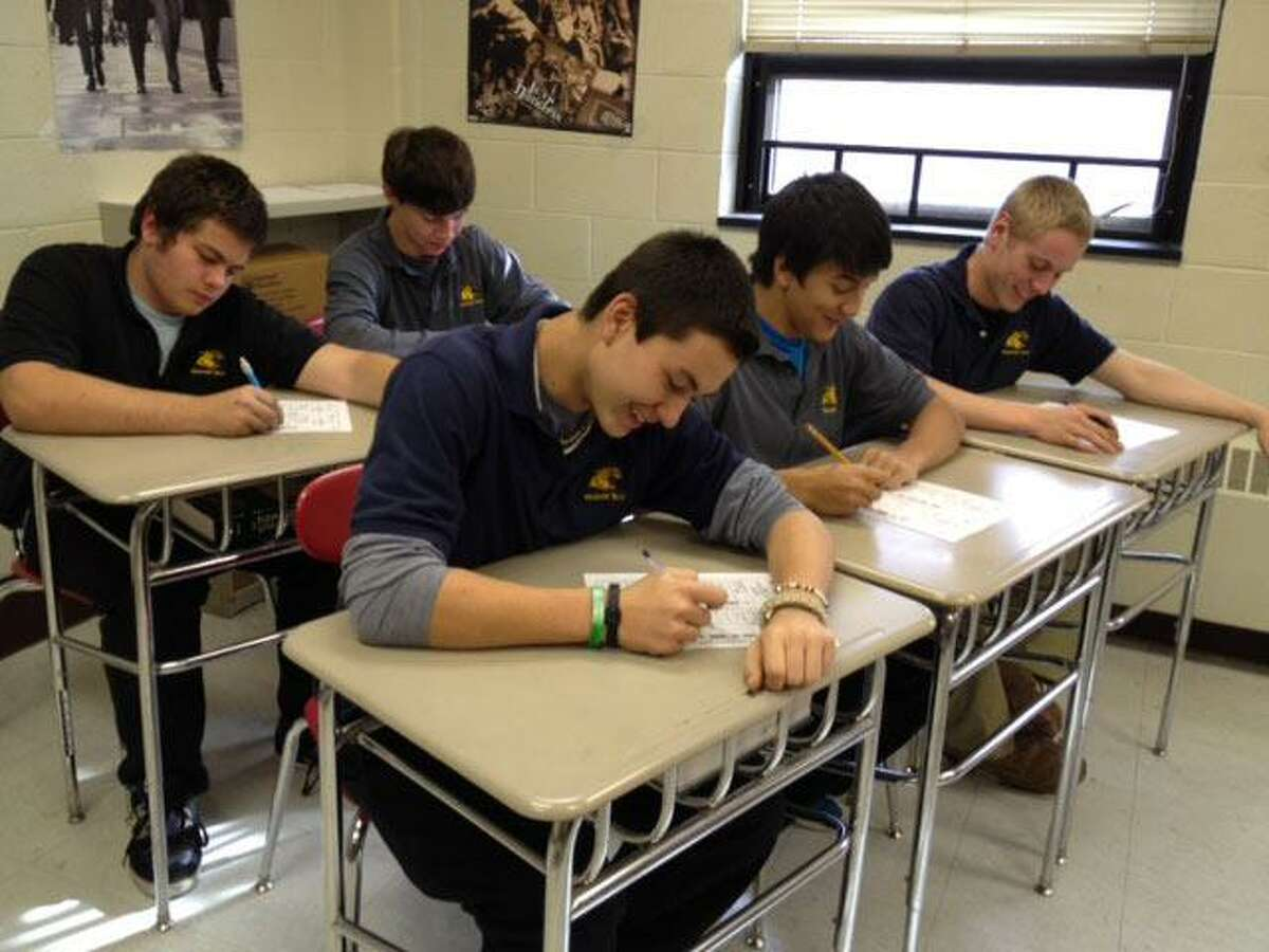 Submitted Photo Students at Oliver Wolcott Technical School vote for President, Connecticut State Senator and other local offices at a mock election on Monday morning. Students in the front row from left to right are Alec Wasilonsky, Scott Noyes and Jordan Terrier. Students in the back row left to right are Luke Pierson and Jeff Negron.