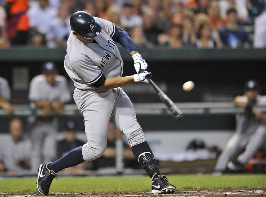 New York Yankees' Alex Rodriguez connects for a single against the Baltimore Orioles in the second inning of a baseball game Friday, Sept. 7, 2012, in Baltimore. The Yankees won 8-5. (AP Photo/Gail Burton) Photo: AP / AP2012