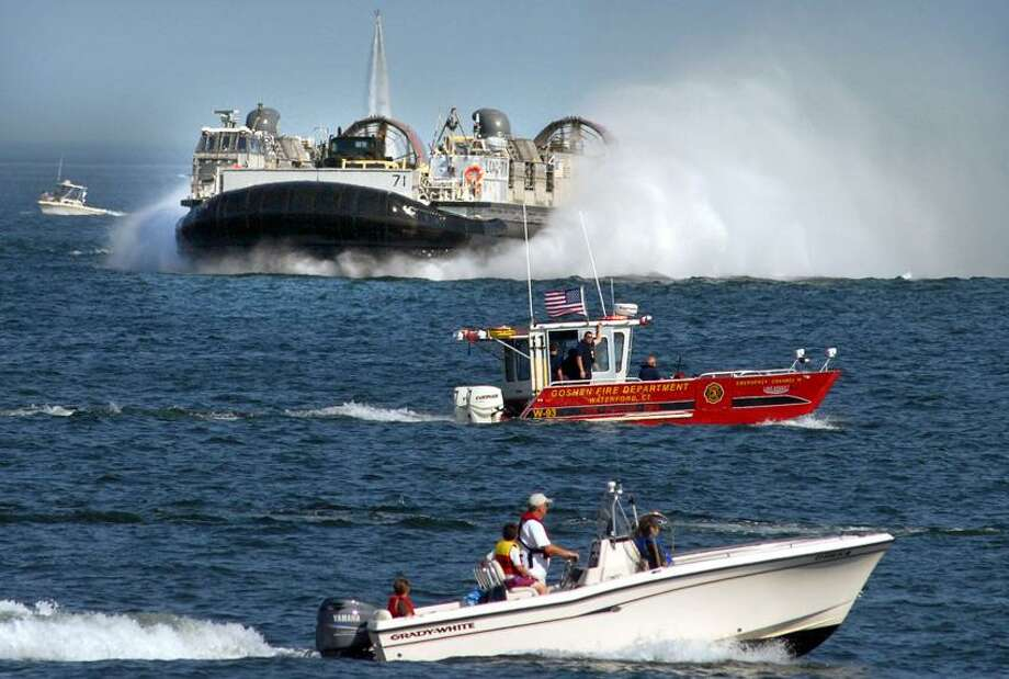 Niantic was the site of a Navy and Marine amphibious landing demonstration as part of OpSail 2012 CT. The LCAC (Landing Craft Air Cushion) or hovercraft zooms toward the Hole in the Wall Beach, McCook Point Park. Mara Lavitt/New Haven Register7/6/12
