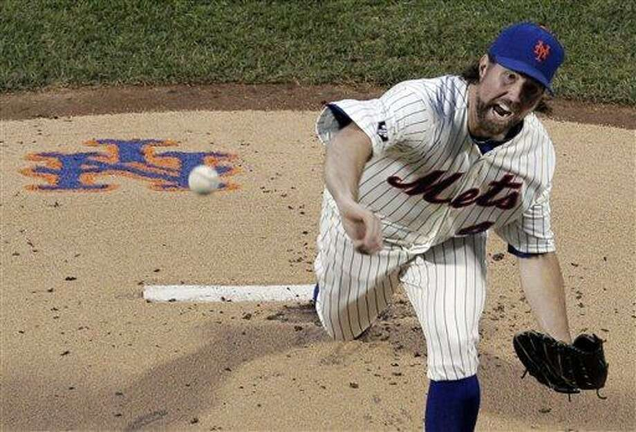 New York Mets starting pitcher R.A. Dickey throws during the second inning of a baseball game against the New York Yankees at Citi Field in New York, Sunday, June 24, 2012. (AP Photo/Peter Morgan) Photo: ASSOCIATED PRESS / AP2012